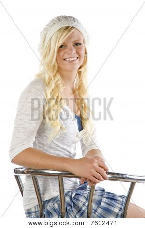 Girl In Blue Skirt In Metal Chair