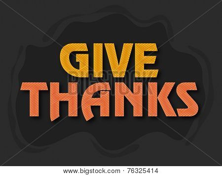 Shiny text Give Thanks on dark background for Happy Thanksgiving Day celebrations.