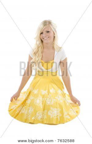Girl Kneeling In Yellow Dress