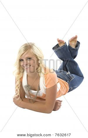 Girl Laying On Stomach In Orange Shirt