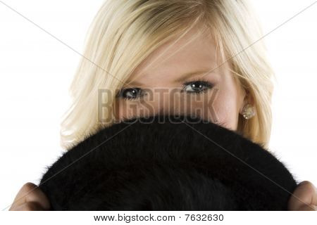 Girl Peaking Over Black Hat