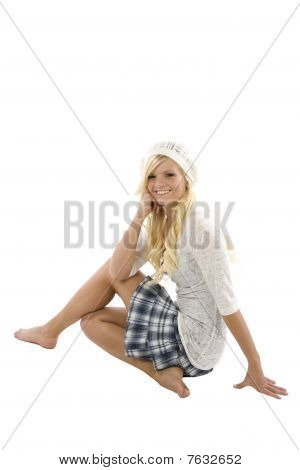 Girl Sitting Sideways With Blue Skirt