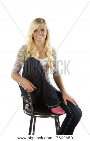 Girl Sitting On Chair With Pink Shoes