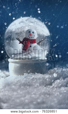 Snow globe in a snowy winter background
