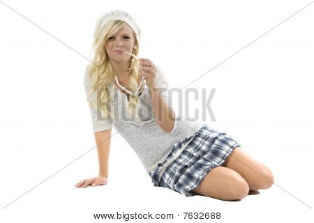 Girl With Blue Skirt And Glasses In Mouth