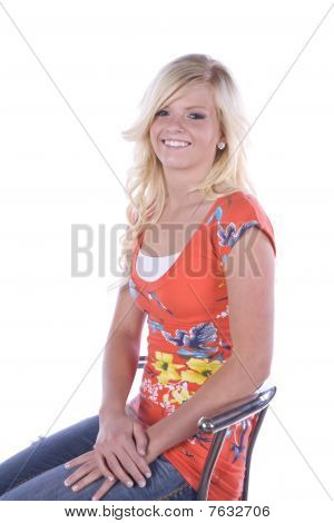 Girl With Flower Shirt On Chair