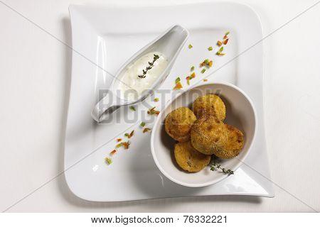 Poatoe Dumplings With Sauce
