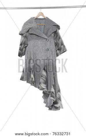 Elegant, stylish woman on a hanger-gray background