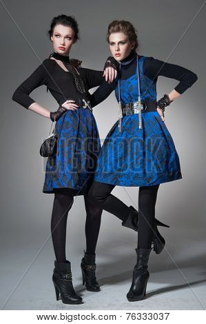 full-length high young stylish two model in fashion dress posing in the studio