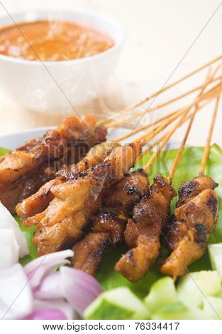 Chicken sate or satay, skewered and grilled meat, served with peanut sauce. Fresh cooked with steamed and smoke. Delicious hot and spicy Asian dish.