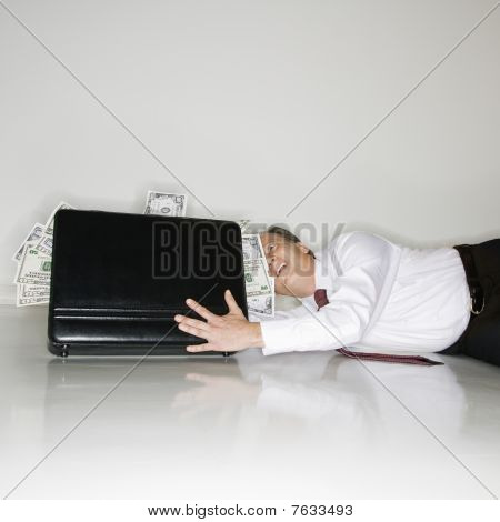 Businessman Grabbing Money