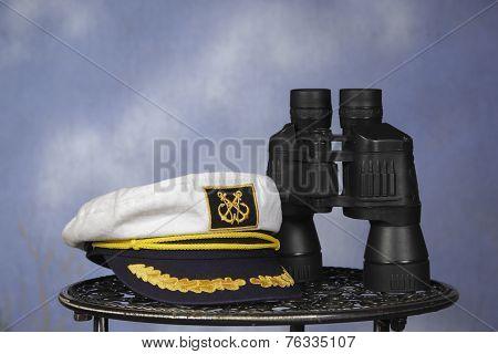 captain hat with black binoculars