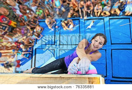 Female climber participating in competition