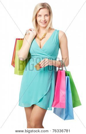 Elegant shopaholic holding multi-color paperbags and discount card