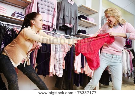 Female shoppers fighting for the last tanktop in department store