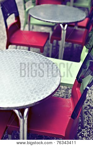 Chairs and tables on the terrace of a bar in Zaragoza, Spain.