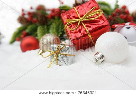 Christmas gifts nestled in snow
