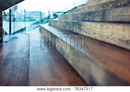 Close-up old wooden stair in modern interior. Beautiful DOF effect