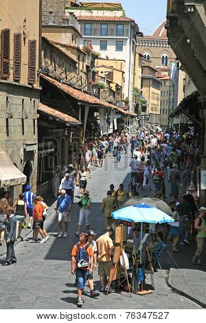 Tourists On The Medieval Bridge Ponte Vecchio