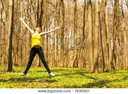 Happy woman jumping in spring nature