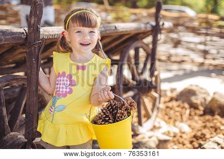 Happy little girl playing outdoors in the countryside.
