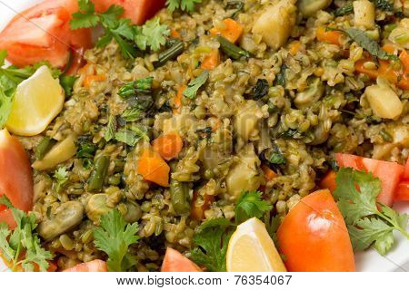 Traditional Egyptian freek vegetable pilaf, with the roasted wheat grain taking the place of rice, as freekeh (or frikeh) is cooked in stock with chopped veg.