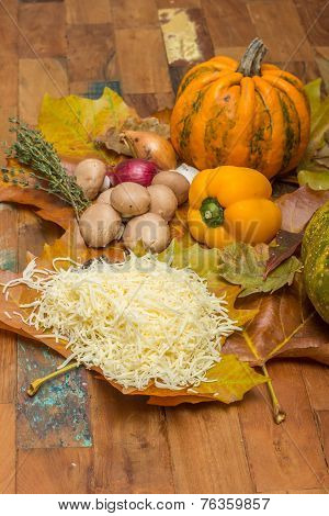 Ingredients For Cheese Fondue On Autumn Leaves