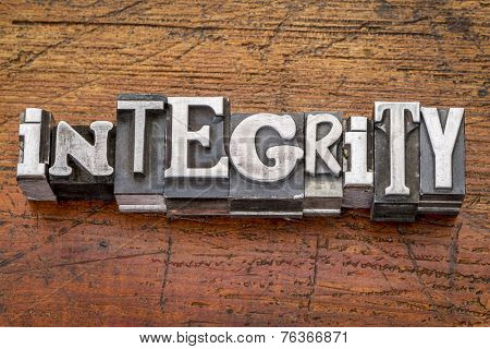integrity word in vintage metal type printing blocks over grunge wood