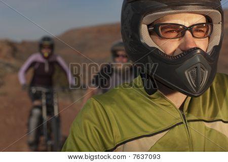 Mountain Bikers On A Desert Trail