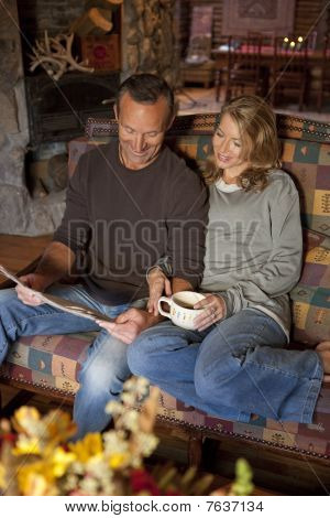 Couple Smiling And Sitting On A Couch