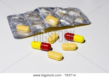 red and yellow tablets