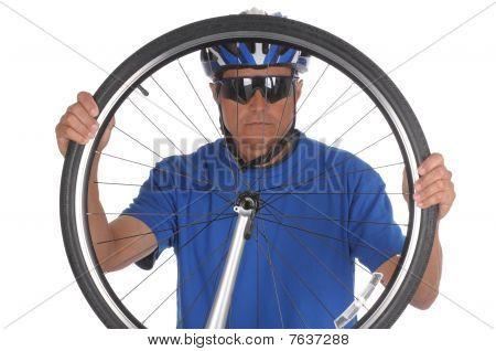 Cyclist Looking Thru Wheel