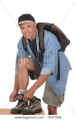 Middle Aged Man Preparing For A Hike