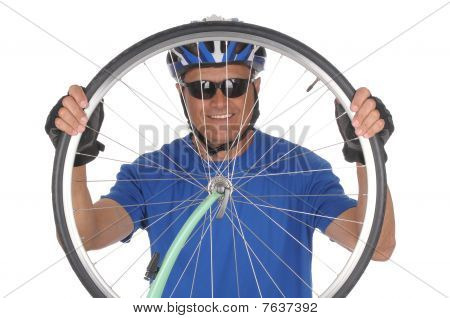 Cyclist Looking Through Wheel