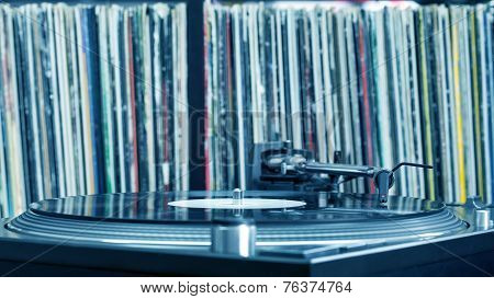 Dj Turntable On Vinyl Background