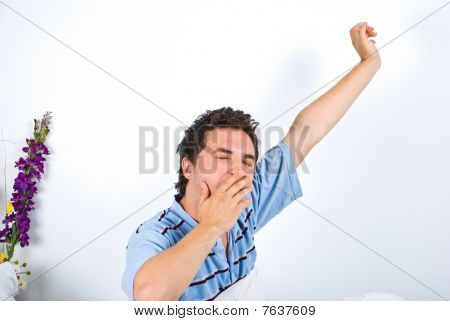 Man Yawning And Stretching His Hand