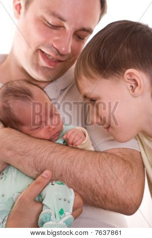 Father Holding Newborn