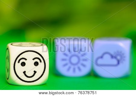 Concept Of Good  Summer Weather - Emoticon And Weather Dice On Green Background