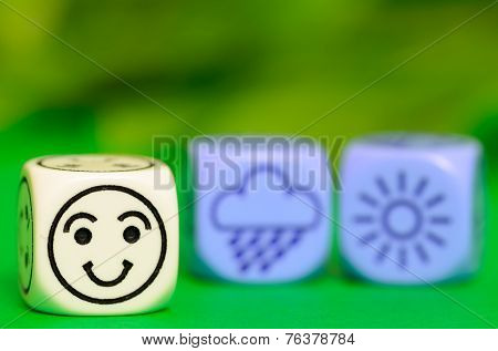 Concept Of Summer Weather - Emoticon And Weather Dice On Green Background