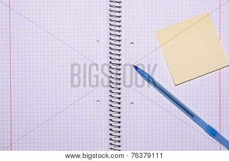 Open Exercise Book With Sticky Card And Pen Seen From Top
