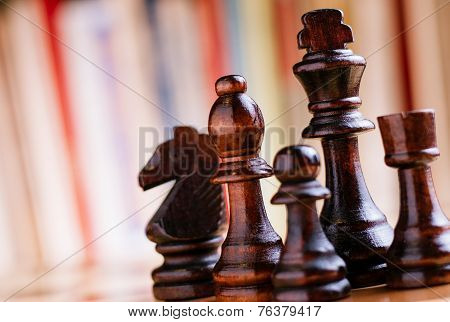 Glossy Black Wooden Chess Pieces On Board