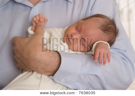 Newborn Sleeping Peacefully And Keeps The Finger Father