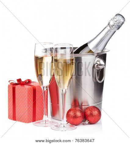 Christmas champagne in bucket and gift box. Isolated on white background