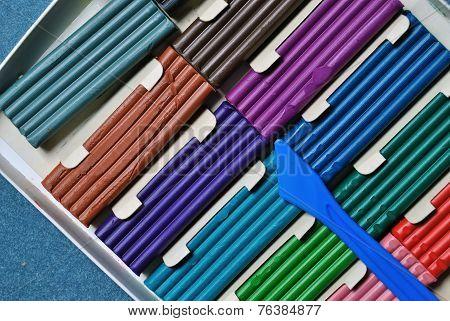 color plasticine box om blue velvet background