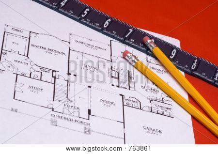 Ruler and pencils on house floorplan