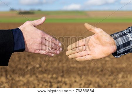 Handshake Between Businessman And Farmer