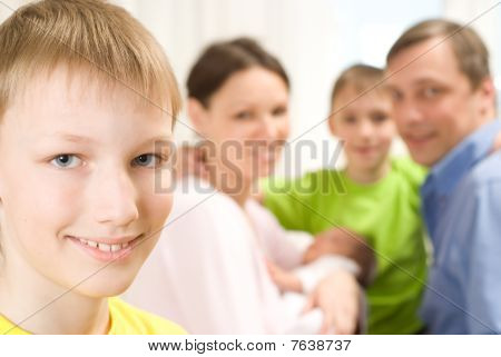 Boy Next To His Family