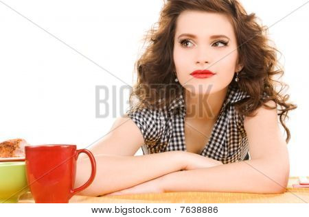 Young Attractive Woman In The Kitchen