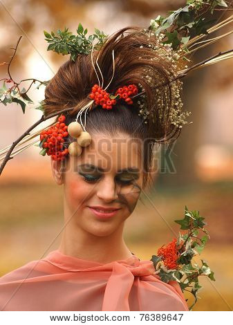 Portrait Of Beautiful Girl With Autumn Leaves And With Stylish Makeup