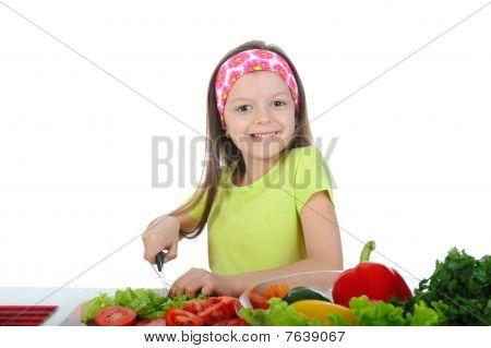 Little Girl Cut Fresh Tomatoes.
